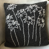 Dark grey hand knitted cushion with embroidered nigella flower heads