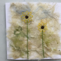 Embroidered sunflowers on handmade silk paper