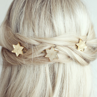 Star shaped hair grips in gold or silver