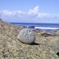 Love carved beach pebble.
