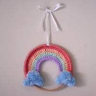 Small pastel rainbow crochet wall hanging hoop with handmade pompom clouds
