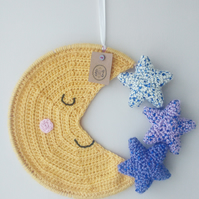 Sleepy crescent moon crochet nursery mooncatcher wall hanging with sequin stars