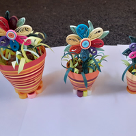 A set of 3 quilled flowers in pots