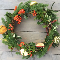 Christmas door hung wreath with real cinnamon and dried fruit