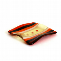 Fused glass plate with orange stripes