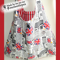 Folding shopping bag in Brit pop, punk, newspaper fabric