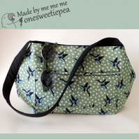 Gorgeous sage green shoulder bag with swallows and bows