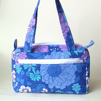 Small, boxy handbag in blue retro, floral print