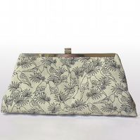 Smart clutch bag with pencil style images of birds, kiss-lock silver tone frame