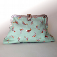 Elegant metal frame clutch bag for bird lover