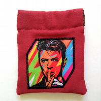 Earbud pouch or coin purse featuring musical legend