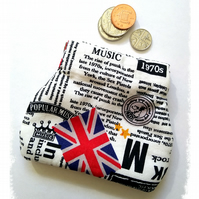 Coin purse or earbud pouch, newsprint fabric with music news from the 1970's