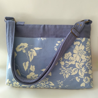 Blue and cream crossbody laptop bag with adjustable strap