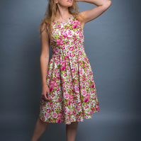 Sleeveless sundress with big gathered skirt and bow in vibrant pink rose print