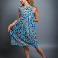Babydoll a-line dress with v-shaped back in floral blue and orange print