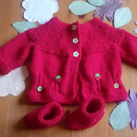 A lovely little red cardigan and matching booties.