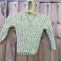Trendy hand knitted baby jumper