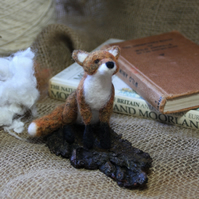 Seated fox - needle felted fox sculpture on a bark base