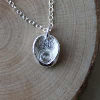 Fine silver 'oyster shell' pendant necklace with moonstone detail