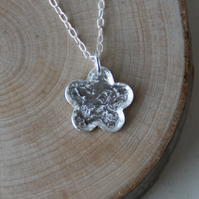 Textured silver flower necklace