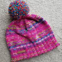 Pink knitted bobble hat