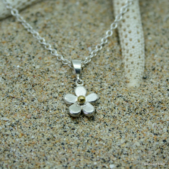 Sterling silver daisy necklace with brass bead centre on silver chain