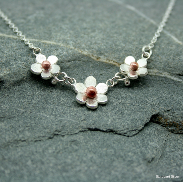 Three daisy necklace in sterling silver with copper bead centres