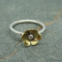 Sterling silver and brass daisy ring with silver bead centre.