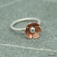 Silver ring with copper daisy.