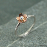 Sterling silver ring with copper daisy