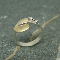 Single brass leaf on a sterling silver band.