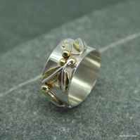 Sterling silver wide ring with brass leaves and floral detail, wedding band