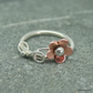 Pretty sterling silver ring with copper daisy and silver tendril.