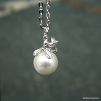 Hummingbird and pearl necklace