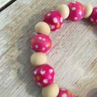 Pink spotty bracelets with natural beads