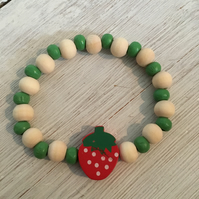 Cute beaded bracelet in green with strawberry bead detail