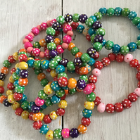 10 colourful spotty wooden bracelets