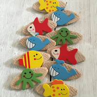 10 wooden badges with a sea life theme