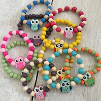 10 wooden bracelets with owl theme
