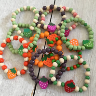 10 wooden bracelets with a strawberry theme