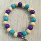 Pretty beaded bracelet with a fairy charm