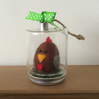 Hand felted brown hen in hanging glass jar.
