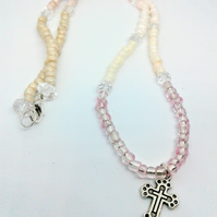 Pink rosary style necklace