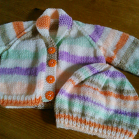 Baby cardigan and matching hat to fit a newborn.