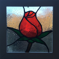 Rosebud - Stained glass in white box frame.