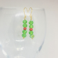 Red and green beaded Christmas earrings