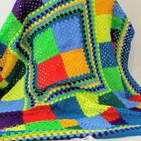 Crochet blanket in bright and cheerful colours.