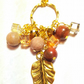 Long gold plated hoop gemstone cluster necklace with rhodocrosite & goldstone