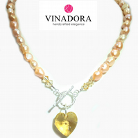 Peach freshwater pearl and Sterling Silver necklace with Swarovski heart