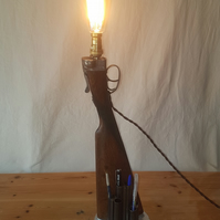 Upcycled desk lamp made of a 1970's walnut stock 12 bore side by side Boxlock
